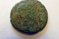 Hadrian copper alloy coin. Reverse shows female standing.